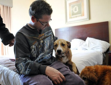 Robert Benner, a resident of Lisa Rigney's Franklin Township home pets Isabella at the Best Western Hotel, in Williamstown, Friday, Feb. 28, 2014. (Staff Photo by Joe Warner/South Jersey Times)