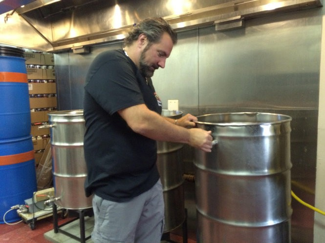 Vince Masciandaro hooks a hose up to the boil kettle at Village Village Idiot Brewing Company in Mount Holly. (Alex Young | For NJ.com)