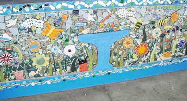 """Select students from Salem High School, community volunteers, artists and faculty at John Fenwick School helped with the installation of a """"peace"""" garden themed mosaic mural at the school's entrance recently. Pictured here is a section of the artwork. (Submitted Photo)"""