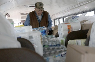 Riley Williams stacking supplies to Stuff The Bus, a benefit in 2012 for Hurricane Sandy victims that was meant to stuff one bus but overflowed to three more buses and a few trucks.