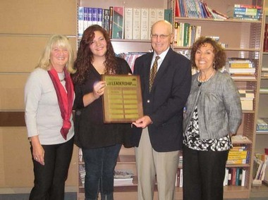 Widener University presented Glassboro High School with a plaque honoring Leadership Award Winner Haley Kopecky. Pictured, left to right, are Margaret Mattioli, guidance counselor; Haley Kopecky, Joe McGeever, assistant director of admissions for Widener University, and Santina Haldeman, GHS principal.