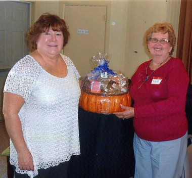 Pictured are President Linda Green and winner Virginia Gandy. A new basket will be offered at each monthly event with all proceeds going to the charity.