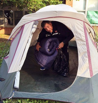 Principal Joe Bollendorf is all smiles as he exits his tent on Thursday morning.