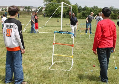 Clayton Middle School Assistant Principal Marv Tucker showing the students the finer points of ladder ball at Clayton's High Schools Renaissance Program BBQ celebration.
