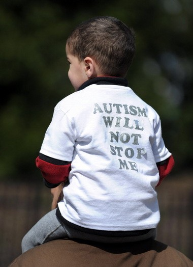 """Devin Hassett, 2, of Allentown, wears a shirt that reads """"Autism will not stop me"""" during the April 20 Walk Now for Autism Speaks at Dorney Park & Wildwater Kingdom. Express-Times Photo   MATT SMITH"""