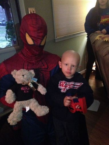 Kayden Dourney, 4, opens gifts brought by Bianca's Kids as he nears the end of chemotherapy treatments or Burkitt's lymphoma. (Photo courtesy of Bianca's Kids)
