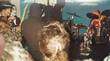 """Bruce Springsteen and members of the E Street Band have masks on as they enter the stage at the Rum Runner in Sea Bright as the """"The Terrorists of Love"""" on Oct. 31, 1987."""
