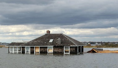 Soft enough for the Sierra Club? The ocean waters that pushed this Mantoloking house into Barnegat Bay also flooded thousands of homes in the mainland sections of Brick and Toms River.