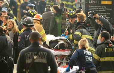 Emergency personnel assist victims after a ferry crashed into a dock in New York this morning.