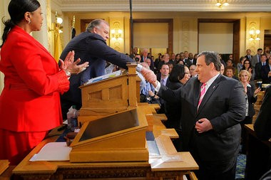 Gov. Chris Christie shakes hands with Senate President Stephen Sweeney (D-Gloucester) as Assembly Speaker Sheila Oliver (D-Essex) looks on as Christie gets ready to deliver his budget speech last week. Christie signed online gambling into law with hours of delivering his address.