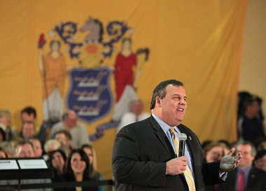 Gov. Chris Christie, shown here speaking at a recent town hall meeting at the Pine Brook Jewish Center in Montville, has benefited from the elaborately staged events.