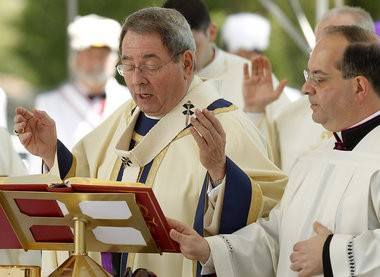 Archbishop John J. Myers, left, celebrates Mass at Holy Cross Cemetery in North Arlington on Memorial Day.