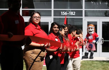 Students hold the ribbon for the opening of the Warren Street Village to house fraternities at New Jersey Institute of Technology in Newark in 2013. (Frances Micklow | Star-Ledger file photo)