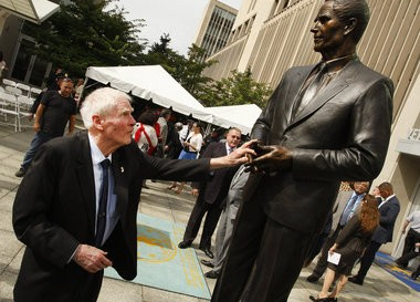 Former Gov. Brendan Byrne touches the statue in his likeness after it was unveiled at a ceremony outside the entrance to the Veterans Courthouse in Newark.