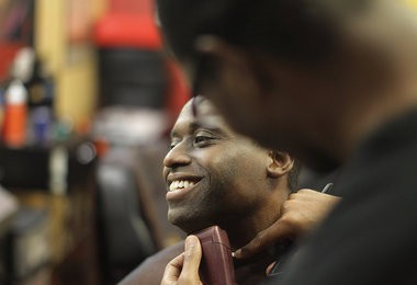 West Orange high school principal Hayden Moore receives a shave from Michael Brooks at the 8 to 8 barber shop during a fundraiser for men's health awareness.