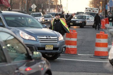 One traffic jam after another: A police officer diverts traffic from Main Street in Fort Lee as Governor Chris Christie meets with the mayor about the George Washington Bridge lane closures.