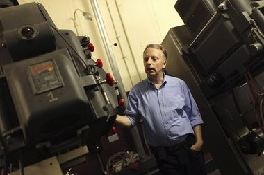 Colin Egan in the projection room at Loews Jersey City, the motion picture palace of Journal Square in Jersey City.