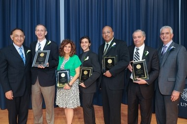 Pictured, (from left): Kean University President Dawood Y. Farahi, Ph.D.; Joseph Bevilacqua '82; Lou Ann K. Behan '80; V.J. Manzo '05; Baruti K. Kafele '86; Kevin B. Alton '73 H'07; and Kean University Alumni Association President Edward Esposito '69 '72. (Photo by Joy Yagid, joyyagid.com)