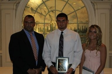Supervisor of Athletics, Health, and Physical Education Gus Kalikas presents Ed Olenick & Bianca Briscese with the Booster Club Outstanding Athlete Awards.