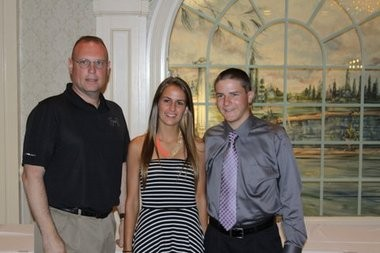 Booster Club President Scott Bohm presents Stephanie Budrock and Matthew Dunn with the Book Scholarship Awards.