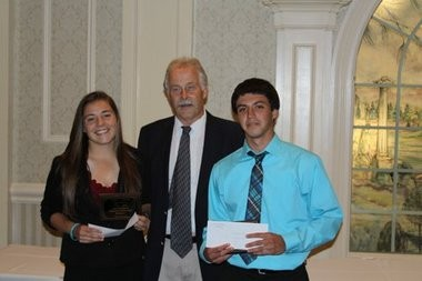 Former Supervisor of Athletics, Health, and Physical Education Carl Peterson presents Jamie Cheeka and Chris Purcell with the Thomas Santaguida Schoarship Awards.
