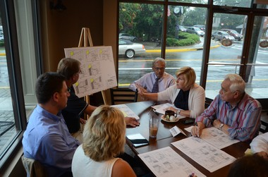 >Mayor Mahr and other Borough officials meeting with merchants to explain the project.