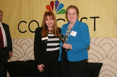 Eleanor McGovern (right), business administrator of Fanwood, accepts the Business Administrator of the Year Award from Angie Tsirkas, vice president at Northfield Bank, at the 25th Annual Mayors Dinner of the Gateway Regional Chamber of Commerce.