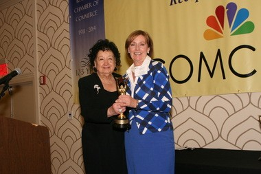 Kathleen Prunty (right), director of the Cranford Office of Business & Economic Development, accepts the Economic Development Director of the Award from Rose Bussiculo, president of Epicor at the 25th Annual Mayors Dinner of the Gateway Regional Chamber of Commerce.