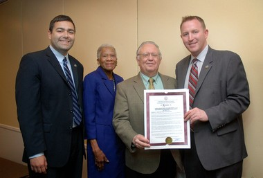 Union County Freeholder Chairman Christopher Hudak (right) and Freeholders Sergio Granados (left) and Vernell Wright present a resolution to Community Access Unlimited Founder and Executive Director Sidney Blanchard congratulating him on the agency celebrating its 35th anniversary. Community Access Unlimited is a multi-faceted, human services agency that provides support services for at–risk youth and people with disabilities. For more information about CAU, visit caunj.org. (Photo by Jim Lowney/County of Union)