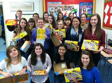Westfield High School Community Service Club supported a school across the globe, in conjunction with a nonprofit founded by a Westfield High School alumna. The club members sold candy in order to raise more than $1,100 for Project MEMA, which supports two schools and several individual students in Moshi, Tanzania. The organization was founded by Amy Wendel (WHS class of '98), and has provided everything from improved facilities to nutritious lunches to scholarships to students in Moshi. The community service club members (pictured with the candy boxes) were led by club President Eric Herber in the fund-raising activities. The money they raised will go directly toward providing rice-and-beans lunches to the Magereza Nursery School in Moshi. In addition, the humanities class taught by English teacher Steve Cohn and social studies teacher Kim Leegan held a jelly bean-counting contest during lunch periods to raise money for the cause. For more information on how to support Project MEMA, visit projectmema.org. For more information about the WHS Community Service Club, email Warren Hynes at whynes@westfieldnjk12.org.