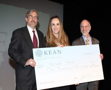 For Kean University graduate student and grand prize winner Fernanda Medros, whose business plan for a craft beer store netted her $1,500, Kean University's second annual Business Plan competition was an introduction to what she might expect if she were to start her own business upon graduation. Pictured (from left) College of Business Dean Michael Cooper with Business Plan Competition winner Fernanda Medros and Kean University Provost Dr. Jeffrey Toney. (courtesy photo)
