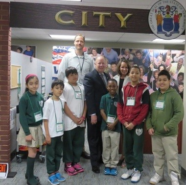 On May 14, the Honorable J. Christian Bollwage of Elizabeth swore in the Mayor of JA BizTown, a fifth grade student from Jerome Dunn Academy for Math, Technology, and the Arts School Number 9 who was elected by his peers prior to their field trip to the JA BizTown simulation. Pictured (center) Mayor Christian Bollwage, City of Elizabeth, shoulder to shoulder with Jerome Dunn Academy for Math, Technology, and the Arts School No. 9 Mayor of JA BizTown, are with 'City Hall' employees, Sebastian de Voogd, fifth grade educator (back row), and Catherine Milone, JANJ President (back row). (courtesy photo)