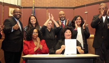 Roselle Mayor Christine Dansereau is flanked by members of Borough Council and the Borough's Office of Hispanic-Latino Affairs following the Oct. 21 passage of the Borough's municipal I.D. ordinance. (courtesy photo)