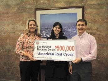 David Erfert, Bayway Refinery manage (right) and Carol Ziegler, Bayway Refinery public affairs manager( left) present a check on behalf of Phillips 66 to Suzanne Lutz of the North Jersey Region of the American Red Cross.