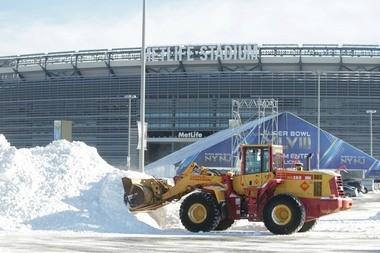 Workers clean snow from MetLife Stadium, which is hosting the Super Bowl this Sunday. Security officials appear to be more concerned about the threat of nasty weather than the threat of terrorism, according to a confidential security assessment.