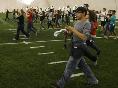 The Rutgers University Marching Band rehearses for the biggest gig in its history -- the pregame at the Super Bowl. Hector Lisboa of Colonia, right, marches as the band transitions into its first set.