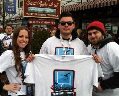 Samantha Scannell, John Peralta and Andrew Russo show off the souvenir t-shirts from East Rutherford's down tailgate party.