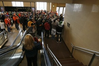 Fans head to Super Bowl 2014 by train at Secaucus, where crowds and heat inside the station have been causing problems.