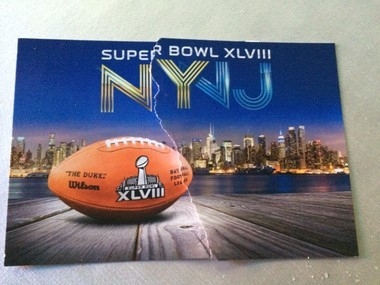 The remnants of two free Super Bowl postcards left outside MetLife Stadium tonight.