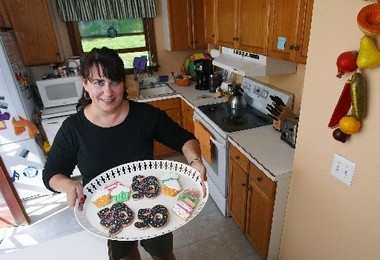 Jolaine Richmond shows off some of the cookies she made for her husband's 50th birthday celebration at her Sparta home.