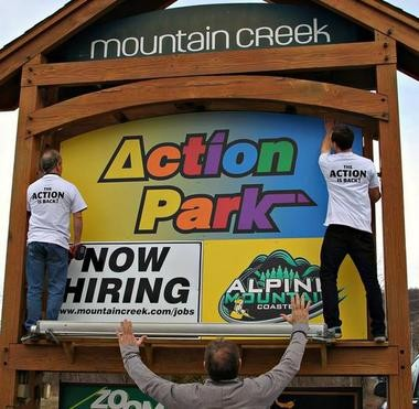 "Workers at Mountain Creek put up a familiar old sign. The ""ACtion Park"" name has returned to the Sussex County water park, after 20 years."