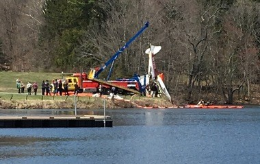 A small plane that crashed Monday into Lake Areoflex being removed Tuesday. (Rob Jennings / NJ Advance Media for NJ.com)