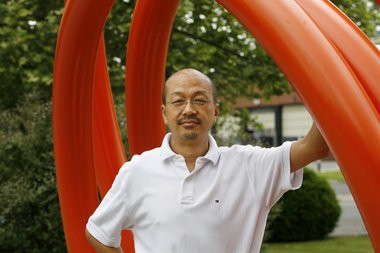 Barry Zhang, president of Princetel stands by a sculpture by Brooklyn, NY based artist John Clement, outside the Princetel facility in Hamilton Township on Wednesday, May 23, 2012. Martin Griff / The Times of Trenton. To purchase prints of this photo, visit TimesofTrenton.zenfolio.com