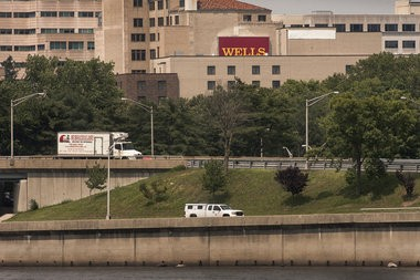 """To the right of the top of a Wells Fargo sign visible on the Trenton skyline, the """"Marriott"""" sign is covered with a plain white banner on the Lafayette Yard Hotel and Conference Center in Trenton, New Jersey. Michael Mancuso/The Times To purchase prints of this photo, visit TimesofTrenton.zenfolio.com"""