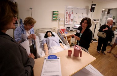 Instructor Debbie Lynn Capik (black jacket) leads a tour of New JerseyâÂÂs newest nursing simulation laboratory at the Cary Edwards School of Nursing, located in the Kuser Mansion Carriage House on Thursday, August 8, 2013. Martin Griff / The Times of Trenton To purchase prints of this photo, visit TimesofTrenton.zenfolio.com
