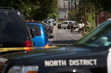 Trenton police investigate the scene on Hobart Ave in Trenton in the morning of Thursday, August 15, 2013, where the two officers were wounded in a shootout with a suspect while following up on a domestic violence investigation. Michael Mancuso/The Times