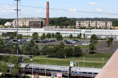 The Crossings at Hamilton Station, a town home and condominium housing development (in background) photographed from the parking garage at the Hamilton Township Train Station in Hamilton Township on Friday, August 16, 2013. Martin Griff / The Times of Trenton To purchase prints of this photo, visit TimesofTrenton.zenfolio.com