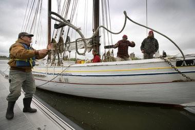 Crew member Tom Nichols, left, reaches for a rope, Thursday, May 5 (Michael Mancuso | For NJ.com