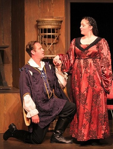 """John Helmeke, as Bassanio, courts Portia, played by Kyla Mostello Donnelly, in the Off-Broadstreet Theatre's production of Shakespeare's """"The Merchant of Venice."""""""
