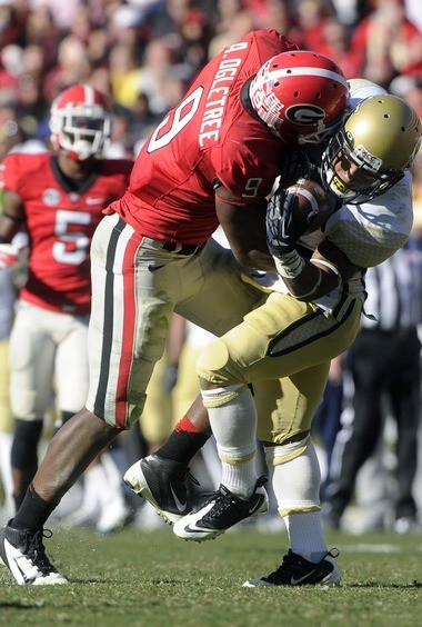 Georgia linebacker Alec Ogletree, left, takes down Georgia Tech running back Synjyn Days for a loss during the third quarter of a game back in November 2012.